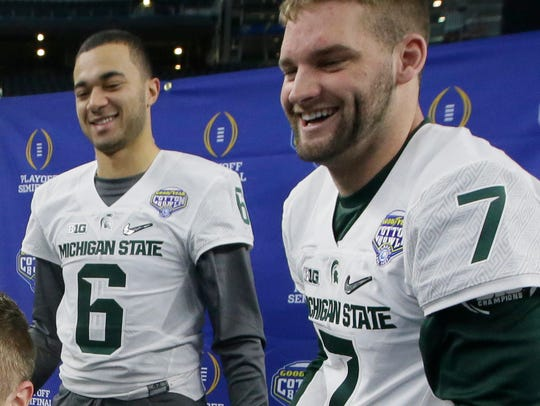 Michigan State quarterbacks Damion Terry (6) and Tyler