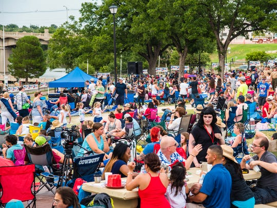 Thousands gather on both sides of the Concho River