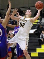 Kristyn Archuleta puts up a shot on Tuesday night. Archuleta tallied 16 points in a 49-41 win over Las Cruces High.