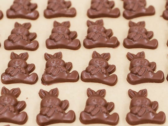 Dozens of different sizes and styles of chocolate bunnies