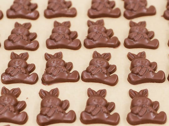 Dozens of different sizes and styles of chocolate bunnies are made before Easter at Seroogy's Chocolates.