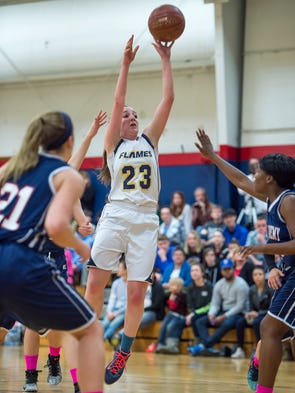 Shalom's Lydia Harris takes a shot at the basket during