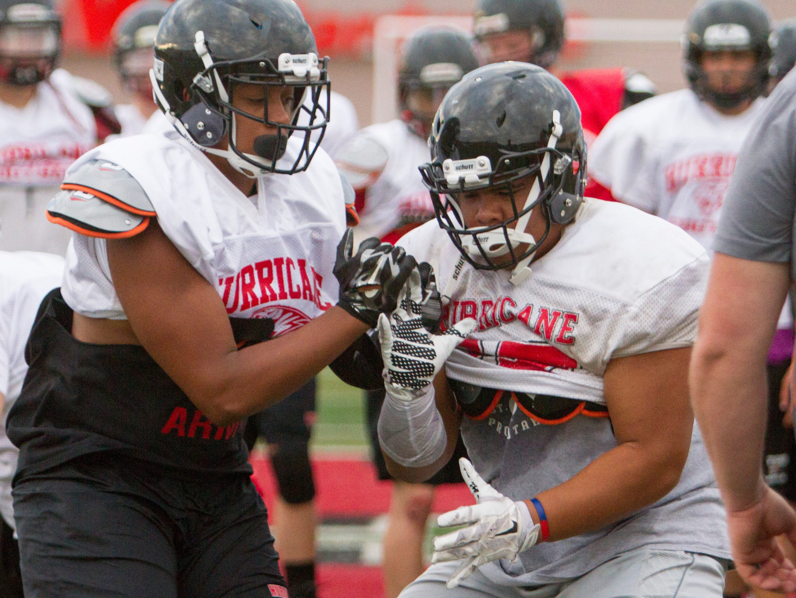 The Hurricane High School football team practices for their upcoming season Thursday, August 4, 2016. The Tigers open the season at home against Skyline on Friday at 7 p.m.