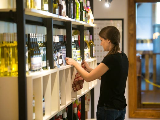 Kait McCane organizes the wine display at Chaddsford Winery which has just unveiled some new wines made in a European-style that was the original concept of the Chadds Ford winery.