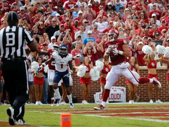 OU wide receiver Lee Morris pulls the ball in for another OU touchdown against UTEP's Kalon Berry in second quarter action.