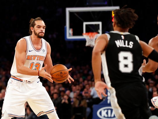 New York Knicks center Joakim Noah (13) passes the