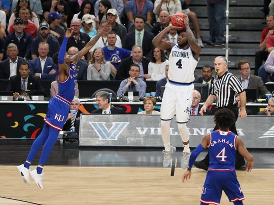 Villanova Wildcats forward Eric Paschall (4) shoots a three-pointer against Kansas Jayhawks guard Lagerald Vick (2) in the second half.
