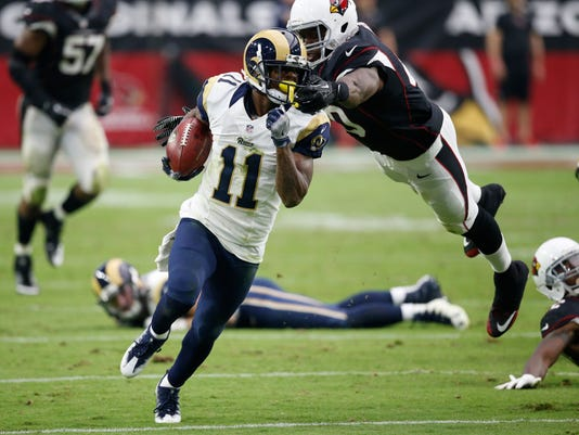 Los Angeles Rams wide receiver Tavon Austin (11) is grabbed by Arizona Cardinals tight end Ifeanyi Momah during the second half of an NFL football game, Sunday, Oct. 2, 2016, in Glendale, Ariz. (AP Photo/Ross D. Franklin)