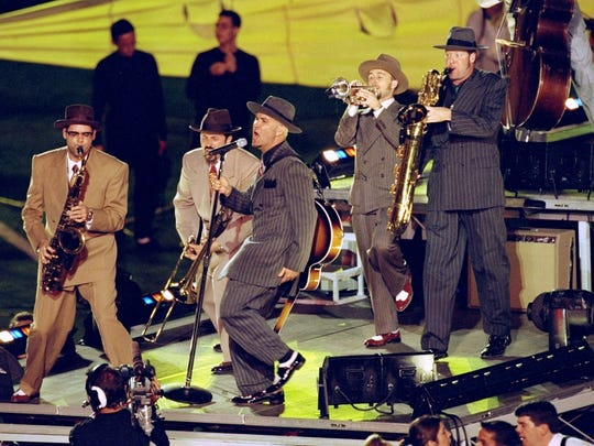Big Bad Voodoo Daddy performing during the half time special of the Super Bowl XXXIII Game between the Denver Broncos and the Atlanta Falcons at the Pro Player Stadium in Miami, Florida. The Broncos defeated the Falcons 34-19.