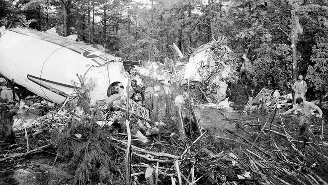 The almost intact main cabin, left, and the completely crushed nose section, center right, of a Douglas Liftmaster transport plane lie in the woods at McGuire Air Force Base, near Fort Dix, after the plane crashed shortly after takeoff on July 13, 1956. Of the 66 people onboard, 45 were killed and 21 injured. The plane was bound for England.