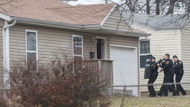 Springfield police clear a home on the 1500 block of East Nora Street after taking a suspect into custody on Friday, Jan. 20, 2017.
