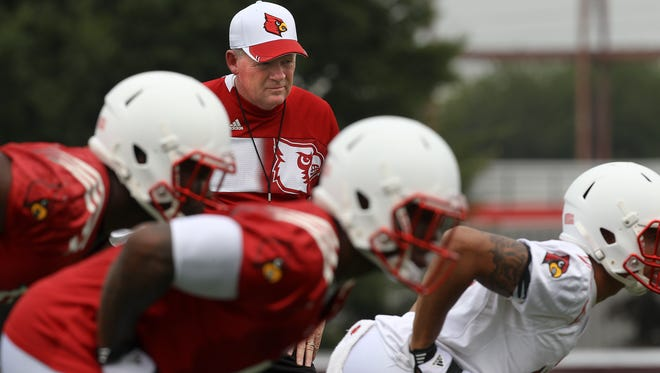 Bobby Petrino watches his players during practice. August 5, 2014
