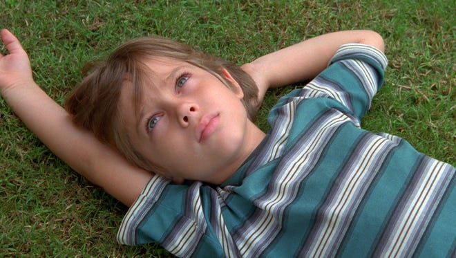 Ellar Coltrane  Ellar Coltrane, the star of the Boyhood, was 6 years old. When the filming concluded, the baby-faced boy had morphed into a long-haired teenager. Coltrane plays Mason in the film and shares the screen with Ethan Hawke and Patricia Arquette, who play his parents.