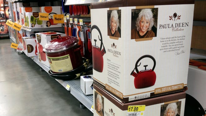 Boxes of Paula Deen tea kettles are displayed in a Little Rock, Ark., Wal-Mart Stores Inc. store Sept. 25, 2013. Despite a July, 2013, announcement that it had ended its relationship with the Southern cook, the retailer said Wednesday it expects to keep her branded cookware on the shelves through the end of the year.