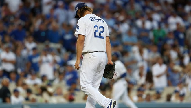 Clayton Kershaw walks off the mound after the St. Louis Cardinals knocked him out in the seventh inning.