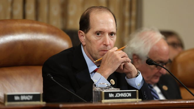 """House Ways and Means Chairman Dave Camp, R-Mich., presiding over an October hearing about implementation of the Affordable Care Act. Camp told reporters Thursday that """"political reality"""" may limit the ability of GOP lawmakers to mount a battle over the debt limit."""