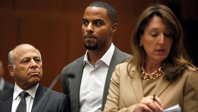A report by a New Orleans police detective says former NFL star Darren Sharper, center, admitted to witnesses that he and another man had sex with two women in New Orleans without the women's consent or knowledge. Sharper has been charged with two rapes in Los Angeles and is suspected of seven others in four other states, including two in Louisiana. All follow a similar pattern: Women who say they were drugged or given drinks by Sharper, who then raped them.