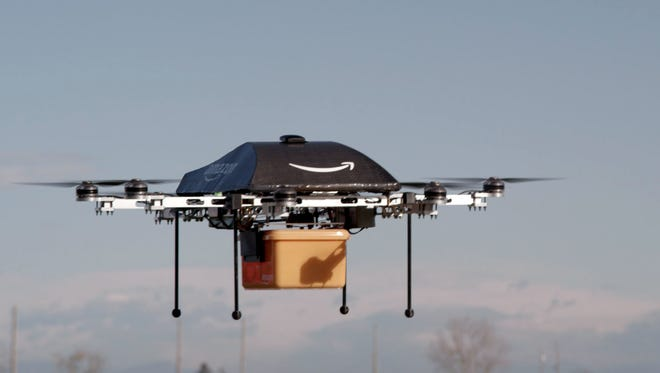 "A flying ""octocopter"" mini-drone that may one day be used to fly small packages to consumers. Amazon CEO Jeff Bezos revealed on Dec. 1 that his company was looking to the future with plans to use mini-drones for deliveries."