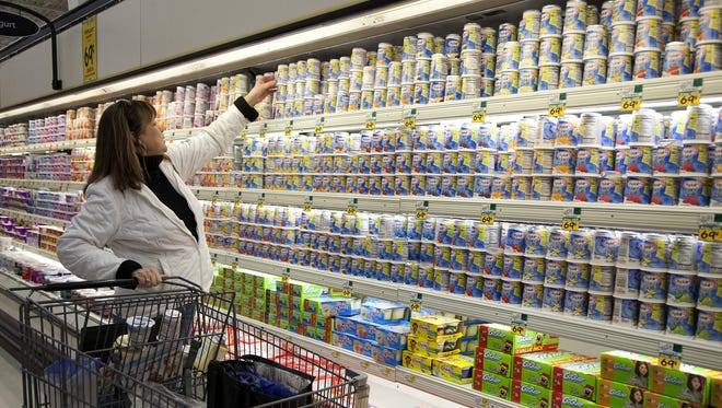 Dona Schneider shops for yogurt at a Cub Foods owned by Supervalu in Crystal, Minnesota on Monday, Jan. 9, 2012.