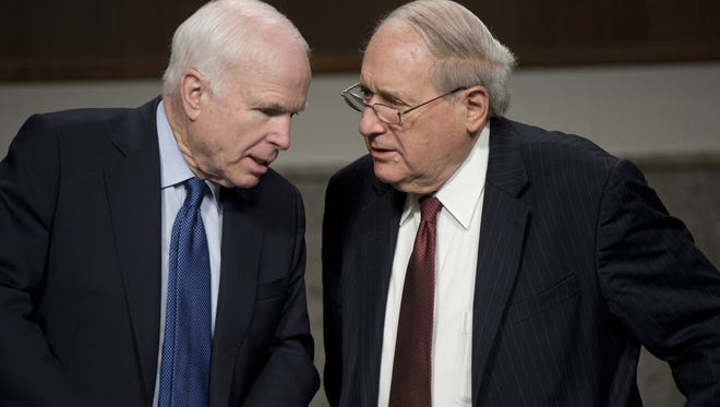 Sen. John McCain, R-Ariz., speaks with Sen. Carl Levin, D-Mich., before a hearing of the Senate Permanent Subcommittee on Investigations hearing in February.