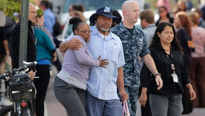 Employees from the Navy Yard complex depart a gathering point for reuniting family members that was set up inside Nationals Park in the wake of the Navy Yard shooting on Monday in Washington, D.C.