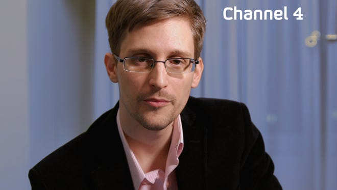 A recent, undated handout picture received from Britain's Channel 4 on Dec. 24 shows U.S. intelligence leaker Edward Snowden preparing to make a televised Christmas message.