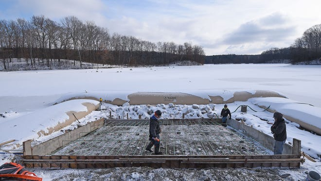 Workers continued to make progress Thursday afternoon on a new boat launch ramp at Charles Mill Lake Marina.