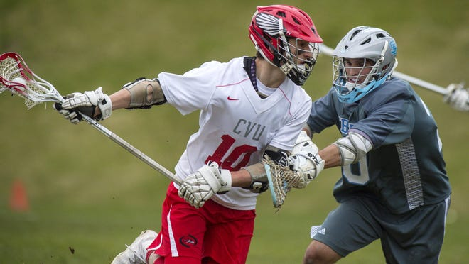 CVU's Griffin Diparlo, left, drives on South Burlington's Colby Barrett earlier this month. Monday, Diparlo helped CVU top Essex.