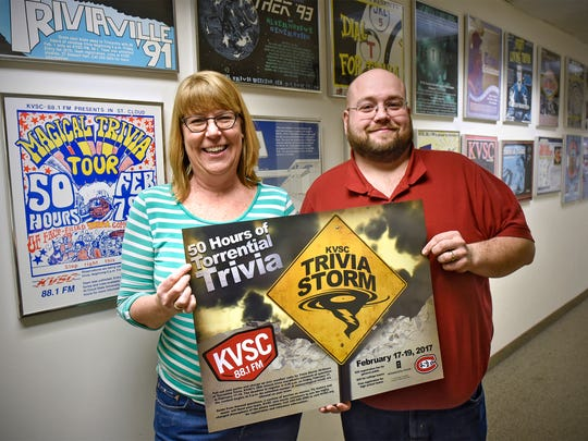 KVSC-FM Station Manager Jo McMullen-Boyer and Operations Director Jim Gray hold a poster promoting this year's trivia contest Friday, Feb. 10, at the station's St. Cloud State University studios.