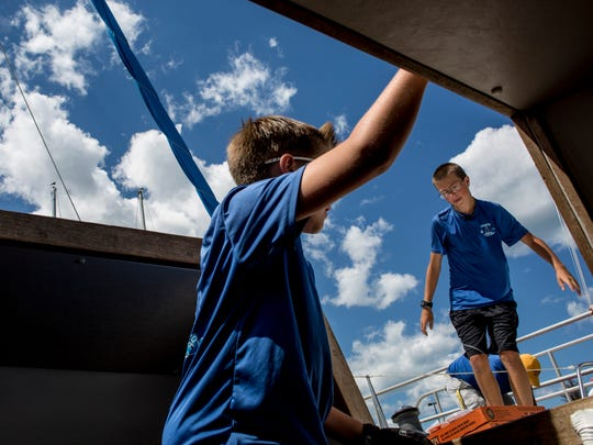 Bryson DenUyl, 14, right, and Brock DenYul, 12, of Good Lookin', prepare the boat Saturday, July 2, 2016 at the Port Huron Yacht Club.