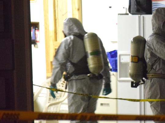 Hazmat crews enter the Knoxville home of Joel and Lisa Guy on Monday, Nov. 28, 2016. Authorities found the couple stabbed to death, dismembered and partially dissolved in acid. The couple's son, Joel Guy, Jr., has been charged in the case, according to the Knox County Sheriff's Office.