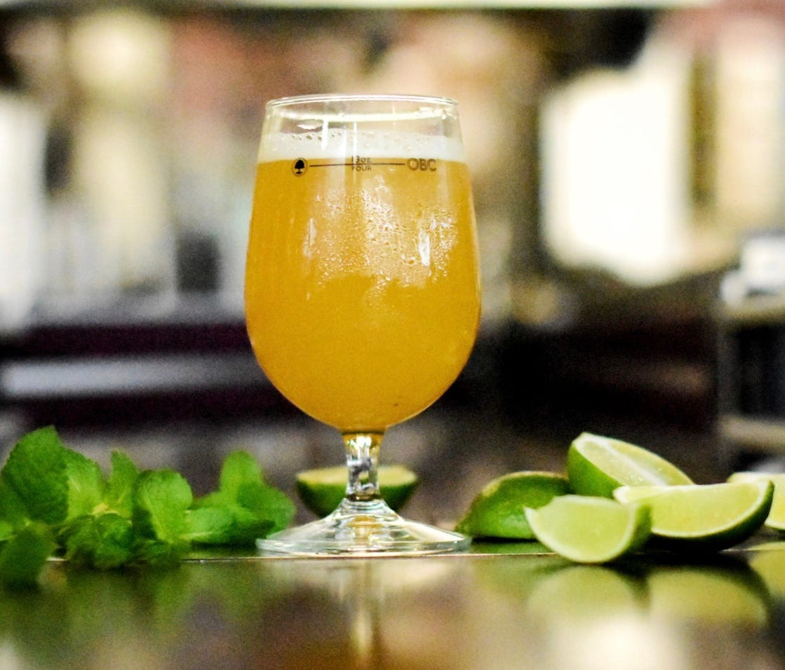 The N2daB, a cross between Farmhouse Saison and Belgian Wheat, nods to the mojito cocktail thanks to a heavy helping of fresh mint and lime zest, both of which are added after fermentation. While it took a whole crew to craft this collaboration, you