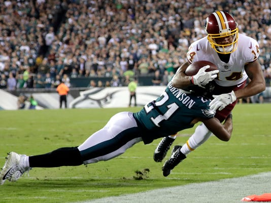 Washington Redskins wide receiver Ryan Grant (14) is hit by Philadelphia Eagles defensive back Patrick Robinson (21) during the first half of an NFL football game, Monday, Oct. 23, 2017, in Philadelphia. (AP Photo/Michael Perez)
