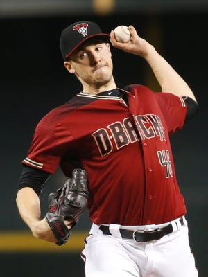 Arizona Diamondbacks starting pitcher Patrick Corbin (46) thaws against the Miami Marlins during the first inning at Chase Field in Phoenix, Ariz. September 24, 2017.