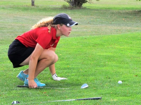 Pinckney freshman Olivia Ohmer, who shot 90, lines up a shot before chipping onto the green in the Southeastern Conference golf tournament at Rustic Glen Golf Course on Sept. 25, 2017.