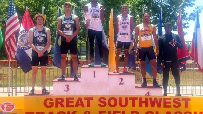 Entering Deming High junior Cesar Chavez (second from right in yellow jersey) celebrated his fourth-place finish on the podium of the 2018 Greater Southwest Track and Field Classic on June 2 in Albuquerque.