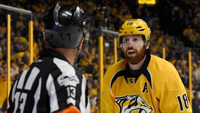 Nashville Predators left wing James Neal (18) talks to referee Dan O'Halloran during the first period in game 6 of the second round NHL Stanley Cup Playoffs at the Bridgestone Arena  Sunday, May 7, 2017, in Nashville, Tenn.