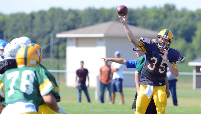 Ashwaubenon quarterback James Morgan throws a pass Friday during a scrimmage against Wrightstown.