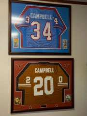 Campbell's jerseys from the Oilers (top) and Longhorns