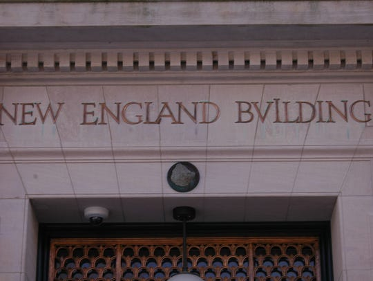 Installed over the main entrance to the New England