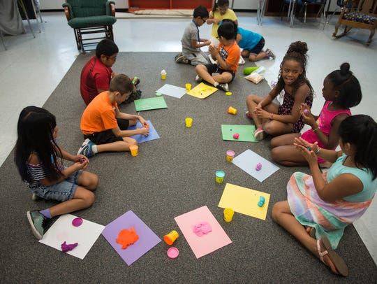 Students build animals out of Play-Doh during the Franklin