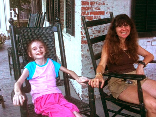 Mandy Fortuna and her mother, Susan, are shown in this undated family photo taken in Grafton.