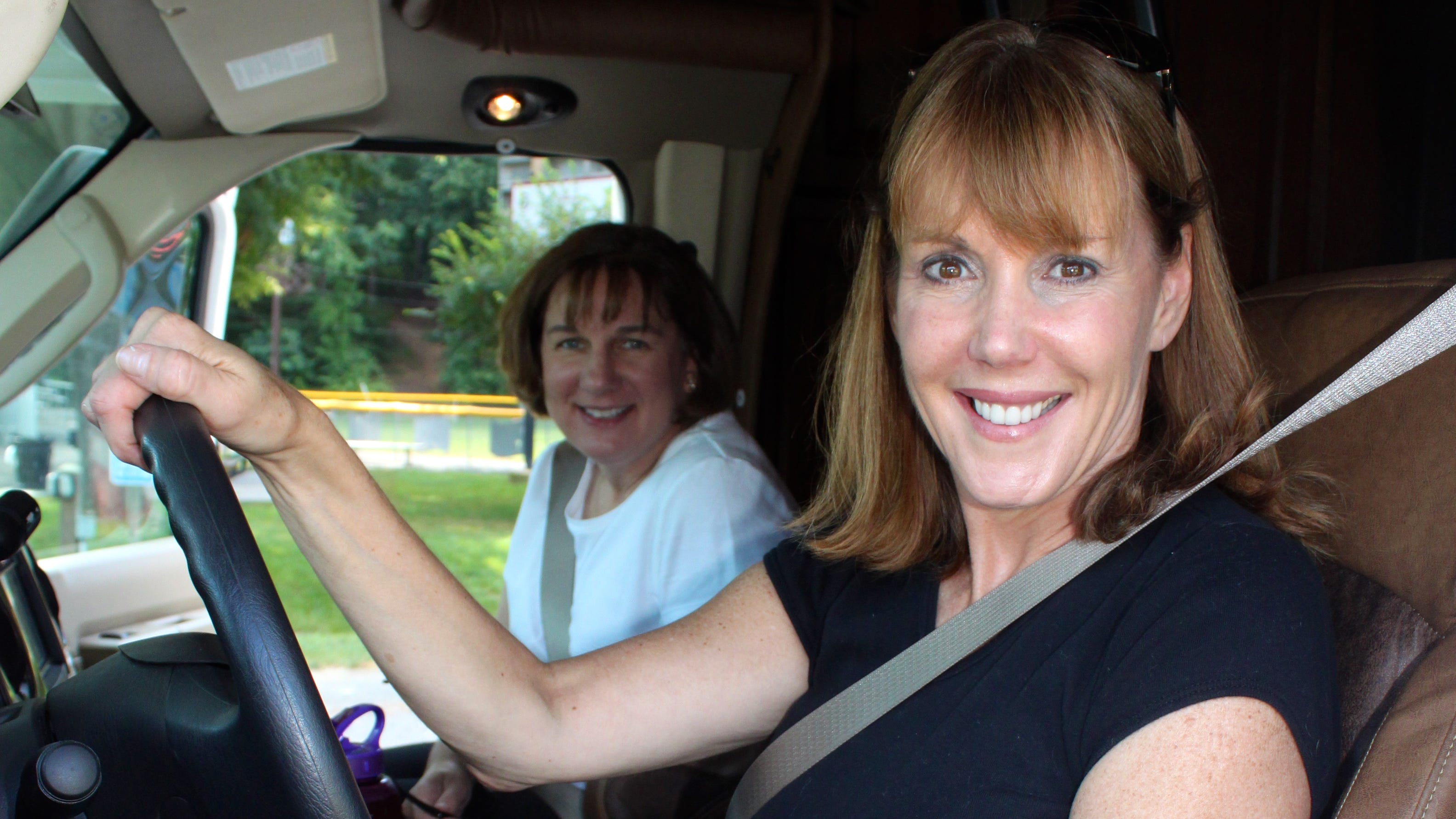 RV newbie Jayne O'Donnell (in the driver seat) and Mary Ellen Stahlman prepare to drive the 700 miles from McLean, Va., to Warner Robins, Ga., for their daughters' softball championship games.