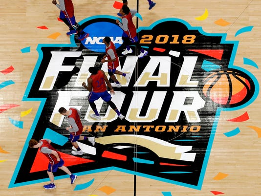 Kansas players warm up on the court during a practice session for the Final Four NCAA college basketball tournament, Friday, March 30, 2018, in San Antonio. (AP Photo/Morry Gash)