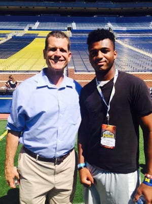 Sir Patrick Scott with Jim Harbaugh.