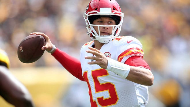 Sep 16, 2018; Pittsburgh, PA, USA;  Kansas City Chiefs quarterback Patrick Mahomes (15) passes against the Pittsburgh Steelers during the first quarter at Heinz Field. Mandatory Credit: Charles LeClaire-USA TODAY Sports