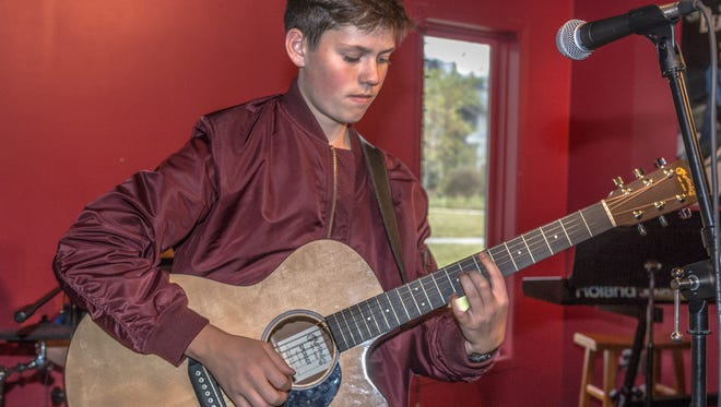 At Pine Rock Studios, students like Emmett Mulrooney, above, learn the art of business – and other life skills – through music.