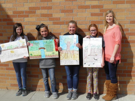 Water Valley Elementary School Fifth Grade Conservation Poster Contest Winners are, from left, Shameray Beise first place; Isabella Rodriguez, second place; Ivy Dill, third place and Emilee Badden, fourth place.  At right is fifth grade teacher Megan Doss.