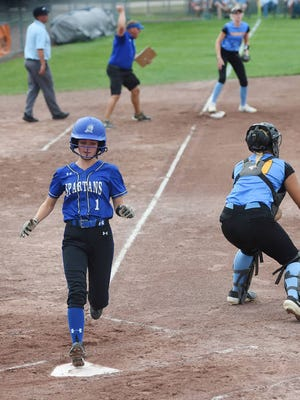 Collins-Maxwell's Avery Fricke scores as Lynnville-Sully's Korinne Jensen waits for the throw during the Spartans' three-run first inning en route to a 7-0 victory in a Class 1A semifinal at the state tournament on Wednesday in Fort Dodge. Photo by Nirmalendu Majumdar/Ames Tribune