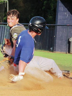 Hunter Harlan, left, shown trying to tag out a runner during 2019 American Legion baseball action, is one of only two returnees to this year's Bartlesville Doenges Ford Indians squad. Even though the Indians (19-U) won't be playing Legion ball this year, they will still have a season despite many challenges. Mike Tupa/Examiner-Enterprise